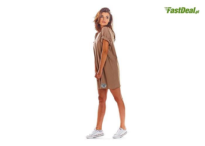 Luźna mini sukienka z krótkimi rękawami, wykonana z przyjemnej tkaniny! Najwyższa jakość wykonania! Modny fason!